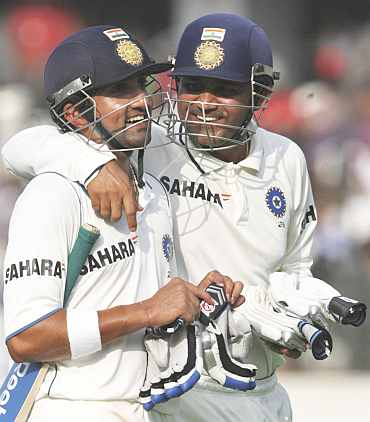 Virender Sehwag and Gautam Gambhir walks back to the pavilion after the Test match