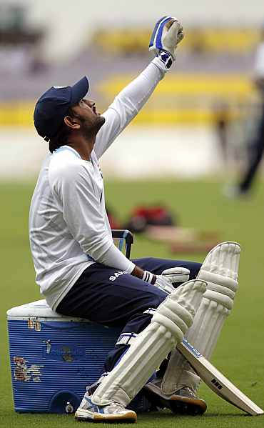 MS Dhoni looks up during a practice session in Nagpur