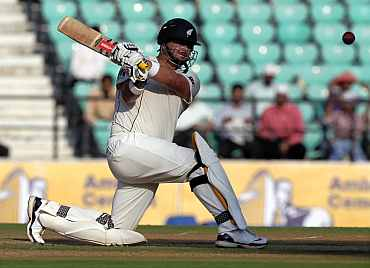Jesse Ryder plays a sweep shot during the third Test against India in Nagpur