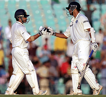 Sachin Tendulkar and Rahul Dravid punch fists
