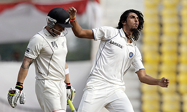 Ishant Sharma celebrates after claiming the wicket of Brendon McCullum