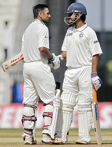 Rahul Dravid is congratulated by Mahendra Singh Dhoni on completing his century on Monday