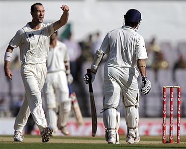 Clint McKay (left) celebrates after claiming the wicket of Sachin Tendulkar on Monday
