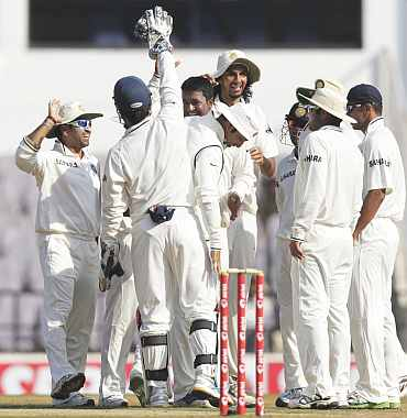 Indian players celebrate after winning the Test match against New Zealand in Nagpur