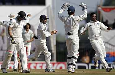 Pragyan Ojha celebrates after dismissing Brendon McCullum