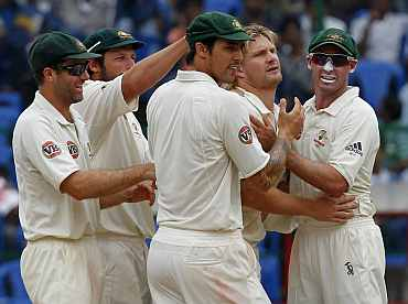 Australian team celebrates after picking up a wicket
