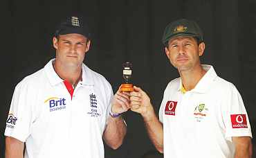 England's captain Andrew Strauss and Australia's captain Ricky Pointing hold the Ashes urn in Brisbane