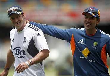 England's captain Andrew Strauss shares a smile with Justin Langer ahead of the first Ashes Test in Brisbane