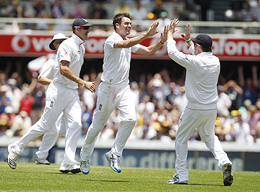 James Anderson celebrates with teammates after claiming the wicket of Ricky Ponting