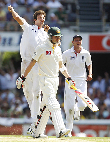 Steve Finn celebrates after dismissing Michael Clarke (right)