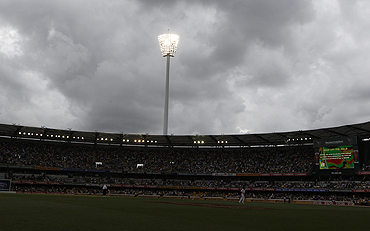 Grey skies surround the Gabba on Friday. Subsequently, play was suspended due to poor light