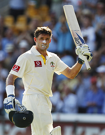 Michael Hussey celebrates after scoring a century on Saturday