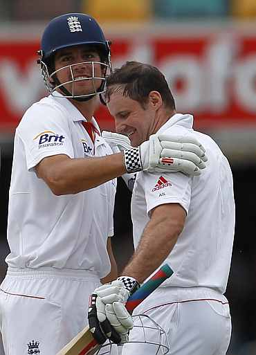 Alastair Cook congratulates Andrew Strauss for his century against Australia during the first Ashes Test in Brisbane