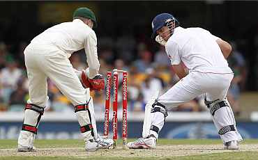 Australia's Brad Haddin tries to stump England's Alastair Cook during the first Ashes Test in Brisbane