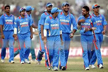 Indian players celebrate after winning the first ODI against New Zealand in Guwahati