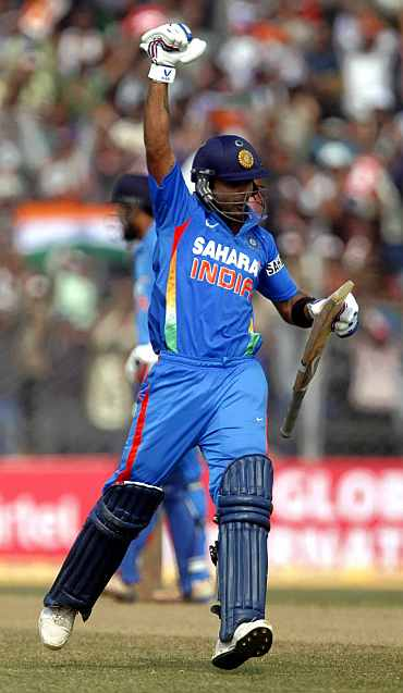 Virat Kohli celebrates after scoring a hundred against New Zealand in Guwahati