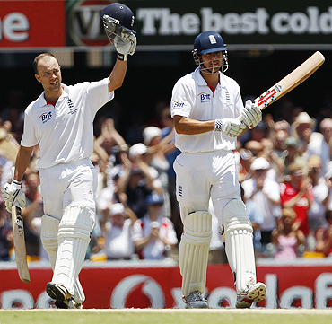 England's Jonathan Trott (left) celebrates his century beside Alastair Cook on Monday