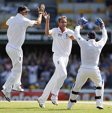 England's Stuart Broad (centre) celebrates with teammates after dismissing Australia's Simon Katich on Monday