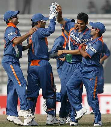 Sudeep Tyagi celebrates during an ODI