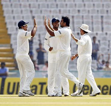 Zaheer Khan (second from right) celebrates with teammates after dismissing Simon Katich leg before wicket