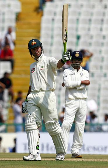 Ricky Ponting raises his bat to the pavilion after scoring 50