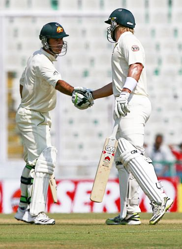 Shane Watson is congratulated by Ponting (left) after getting to his fifty