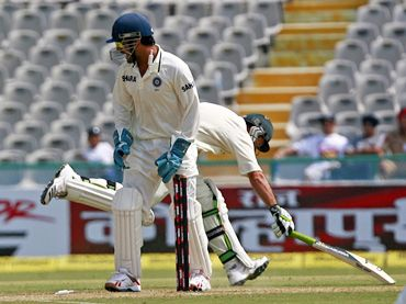 Ponting is caught short off his crease by Raina's (not in pic) throw