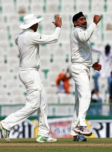 Harbhajan Singh celebrates after having Michael Clarke caught by Rahul Dravid
