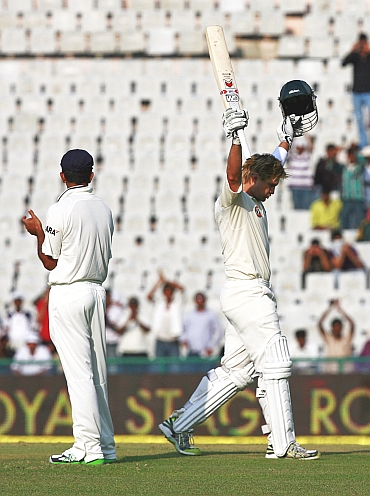 Shane Watson acknowledges the applause after getting to his hundred