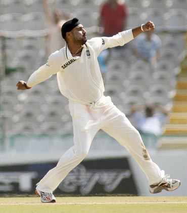 Harbhajan Singh celebrates after dismissing Shane Watson