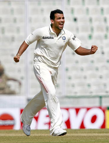 Zaheer celebrates after dismissing Johnson