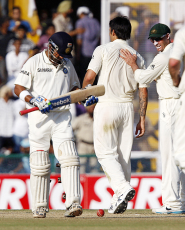 Mitchell Johnson (centre) celebrates with teammates after dismissing India's Gautam Gambhir