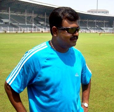 Dravid is congratulated by Tendulkar after scoring 50