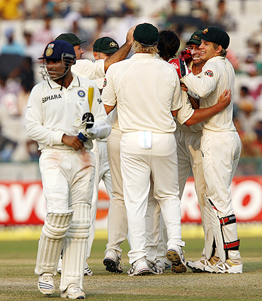 The Australian team celebrates after dismissing Virender Sehwag