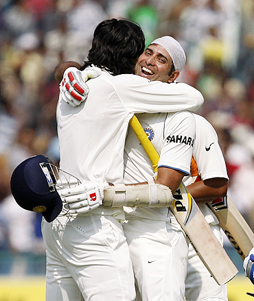 VVS Laxman and Ishant Sharma embrace after the victory