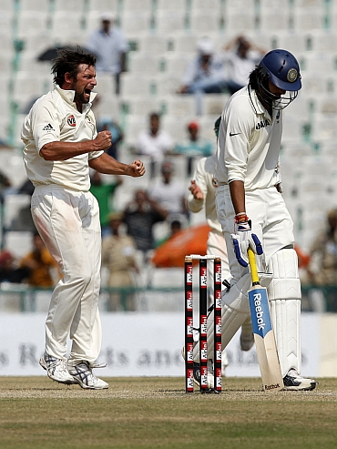 Ben Hilfenhaus celebrates after picking up Ishant Sharma