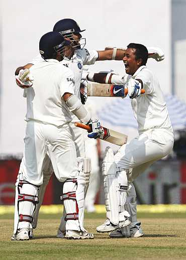 Indian players celebrate after winning the Test