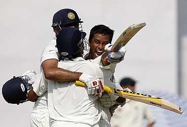 Pragyan Ojha reacts after winning the Mohali Test
