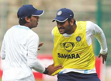 MS Dhoni and Murali Vijay during a practice session