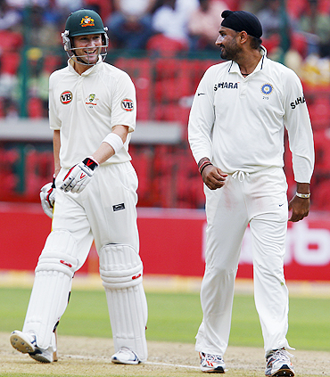 Australia's Michael Clarke (left) shares a laugh with Harbhajan Singh