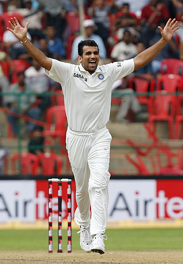 Zaheer Khan celebrates after dismissing Michael Hussey
