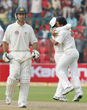 Raina (right) and Sehwag celebrate as Ponting walks off the field after his dismissal