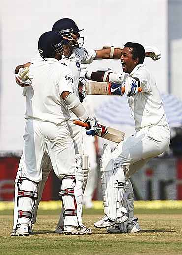 VVS Laxman celebrates after winning the Mohali Test