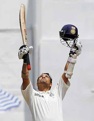 Sachin Tendulkar celebrates after reaching 49th Test century