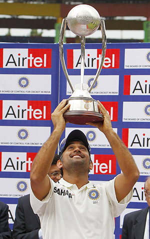 India captain MS Dhoni holds aloft the Border Gavaskar trophy after the series win on Wednesday