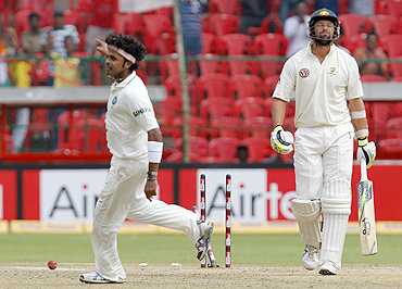 S Sreesanth (left) celebrates after claiming the wicket of Ben Hilfenhaus on Wednesday