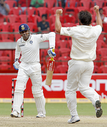 Ben Hilfemhaus (right) celebrates after dismissing Virender Sehwag