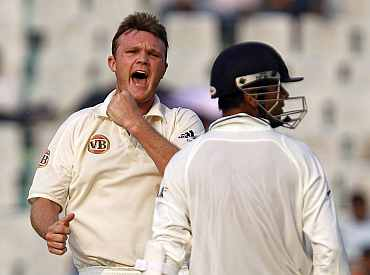 Dougie Bollinger celebrates after dismissing Rahul Dravid