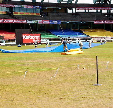 Groundsmen at work ahead of the Kochi one-dayer