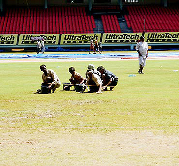 Groundsmen at work in Kochi ahead of the first one-dayer